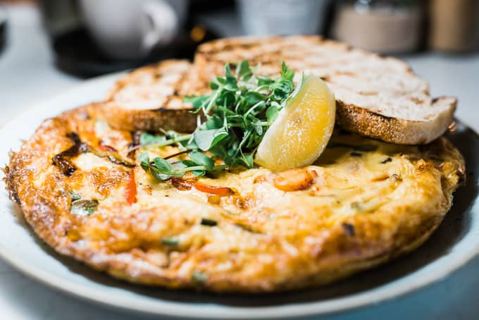 A fluffy and generous 5th Earl Omelette featuring Alaskan King Crab